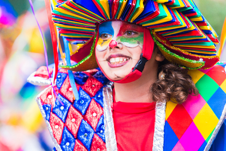 troupe: Badajoz, Spain, sunday. February.26. 2017 Participants in colorful costumes take part in the carnival parade in Badajoz 2017 Editorial