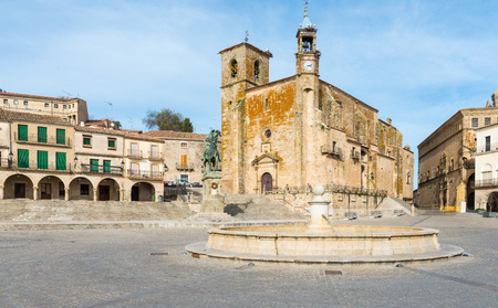 Plaza Mayor at Trujillo . Saint Martins church and statue of Fransisco Pisarro. Trujillo. Spain