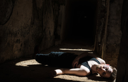 Unconscious man alone in abandoned place after being beaten