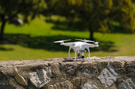 White Drone landed on a wall