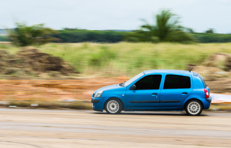 Very fast driving. Blue car competing in drift contest Stock Photo