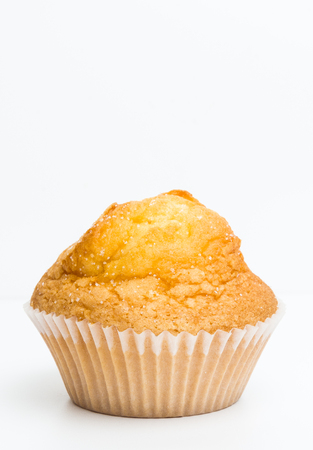 One muffin or magdalena isolated on white background.