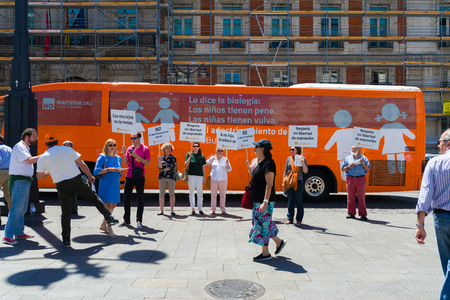 """yourself: Madrid, Spain - june 06, 2017: Bus anti-transgender Hazte Oír (""""Make Yourself Heard"""").Bus   with the message written on the sides Boys have penises, girls have vulvas.Say no to gender indoctrination"""