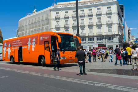"""Madrid, Spain - june 06, 2017: Bus anti-transgender Hazte Oír (""""Make Yourself Heard"""").Bus   with the message written on the sides Boys have penises, girls have vulvas.Say no to gender indoctrination"""