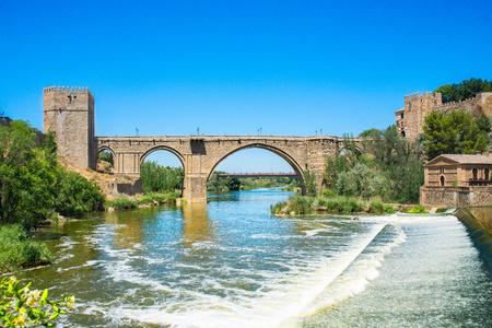 mancha: Saint Martin medieval bridge over tajos river in Toledo, Castilla la Mancha, Spain