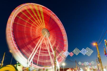 Rotating Ferris wheel  in motion located in Badajoz, Extremadura, Spain