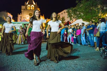 participate: Elvas, Portugal - jun, 30, 2017; Medieval dancers, participate in the medieval festival of Elvas, Portugal
