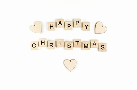 christmas backgrounds: Happy christmas wooden text on a white background