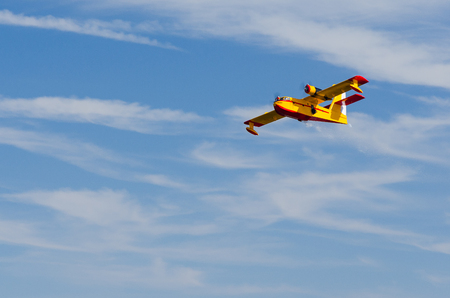 Radio controlled model hydroplane flying over blue sky Stock Photo