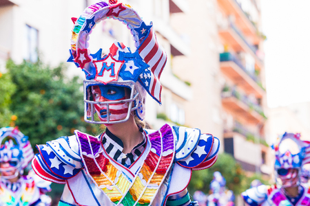 Badajoz, Spain, sunday. February.26. 2017 Participants in colorful costumes take part in the carnival parade in Badajoz 2017 Editorial
