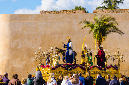 BADAJOZ, SPAIN - MARCH 26, 2018: Image of Jesus riding a donkey, during the celebration of Palm Sunday.