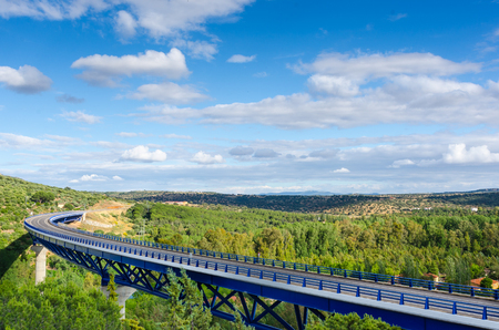 Highway bridge over extremadura forest in landscape, sunny summer day.