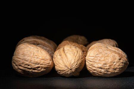 Delicious walnuts on black background Stockfoto