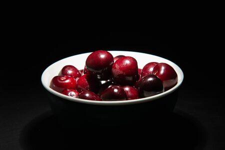 delicious bigarreau cherry in black background