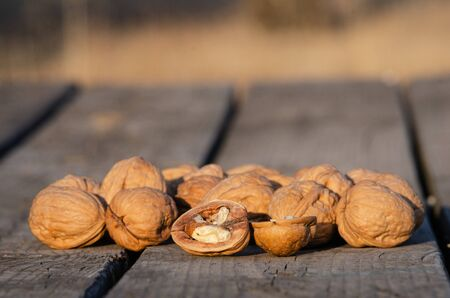 Delicious walnuts on wood table with copy space for text