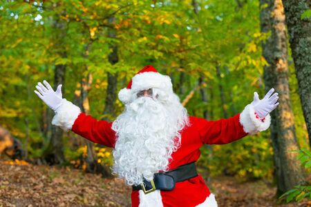 Santa claus in the forest with open arms