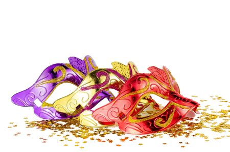 carnival masks and confetti isolated on white background