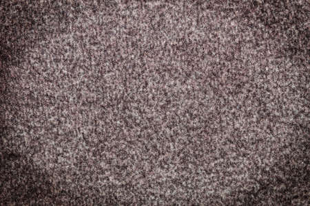 Background. Texture. Tweed fabric with darkened corners.