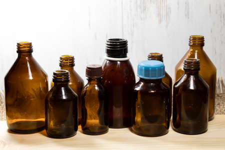 On a white background are medical bottles from under medical drugs.