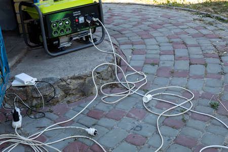 On the porch is a generator from which cords stretch. Two batteries are being charged - additional power supplies.