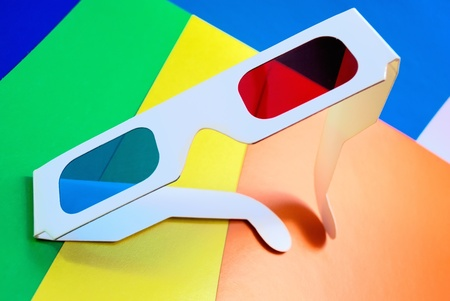 Stereo glasses for viewing anaglyph images on a colorful background. photo
