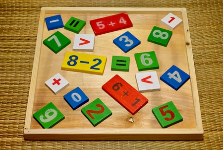 Childrens colored wooden set for the study of mathematics. Cheerful learning toys. Stock Photo