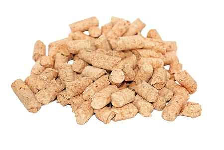 A small heap of wood pressed pellets, isolated on white. photo