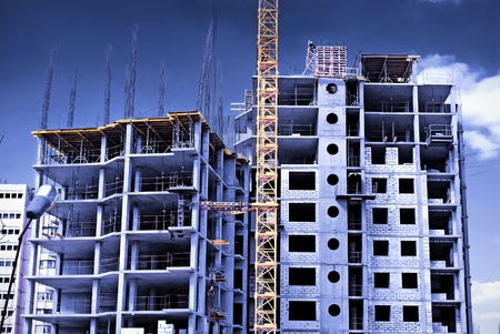 tall building: Construction site in the open air. Crane and unfinished buildings. Stock Photo