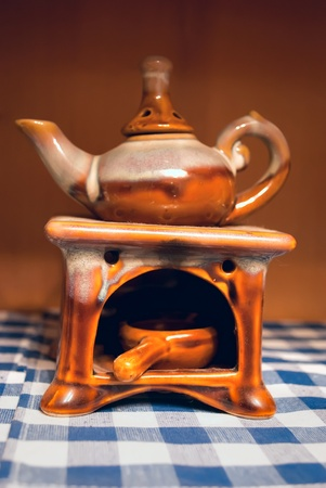 Small oil burner in the shape of a teapot. Stock Photo - 9192707