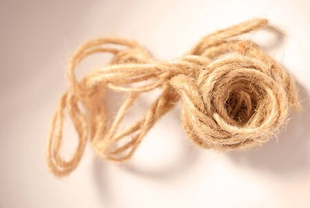 hank: Hank of rough rope with tousled part on a white background. Stock Photo