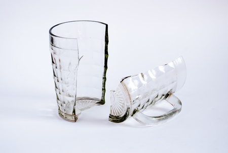 breakage: Beer mug broken in two parts on a white background.