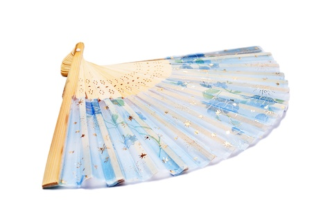 Open blue fan with flowers pattern isolated on  white. Stock Photo - 9683506