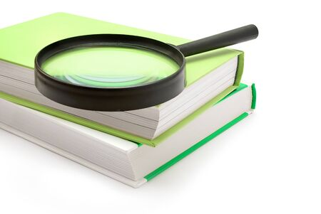 Set for reading - magnifying glass and  books, toned. Stock Photo