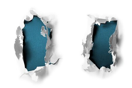 Breakthrough paper holes with blue textured background. Foto de archivo