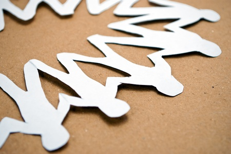 unification: Paper men in unity circle on a cardboard background, fragment.