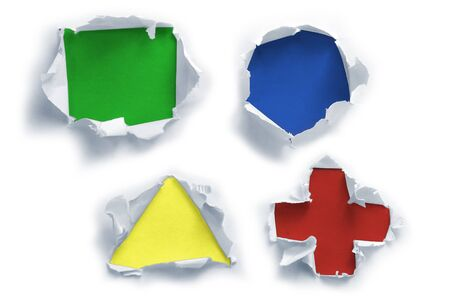 Breakthrough paper figure shaped holes with colorful textured backgrounds. Stock Photo