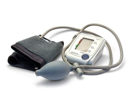 Blood pressure monitor isolated on white. photo