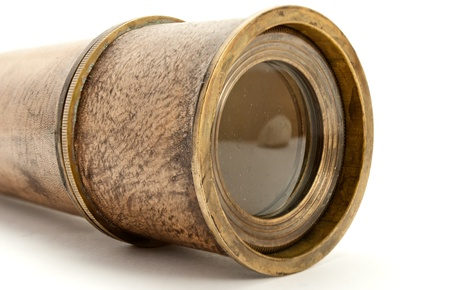spyglass: Closeup of antique spyglass, isolated on white. Stock Photo