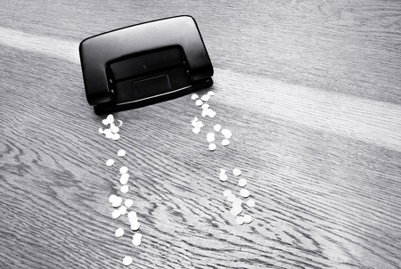 puncher: Hole puncher on a wooden background.