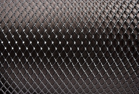 Metal grid on a black background. photo