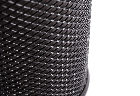 Black mesh cylinder isolated on a white ,fragment. Stock Photo - 10369418