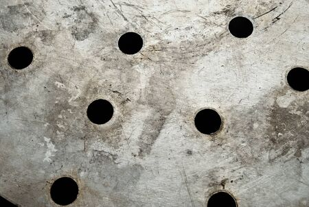 The metal surface with circular holes. Stock Photo - 10369421