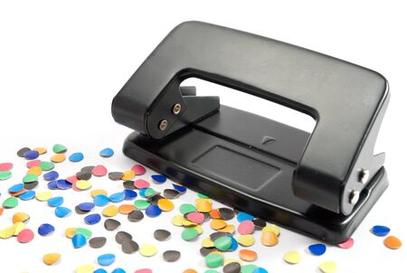 puncher: Hole puncher with some confetti.