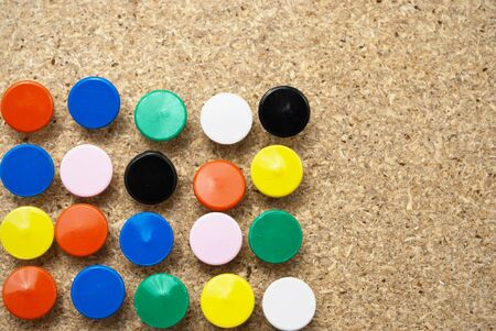 Colorful thumbtacks in a wooden board. Stock Photo - 10392174