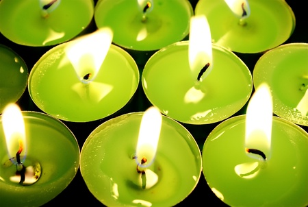 Green tea candles in own light.