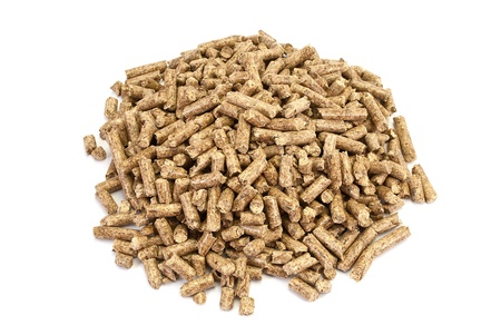 A neat pile of wood pellets, isolated on white.