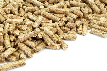 Fragment of  big pile of wood pellets, isolated on white. photo