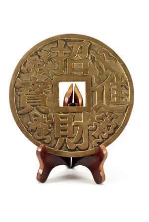 The Chinese coin of happiness on a wooden stand, isolated on white. photo