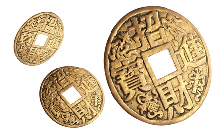 Three Chinese coins of happiness , isolated on white. photo