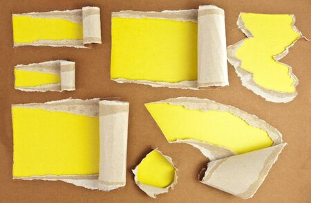 Set of torn paper holes with yellow background. photo